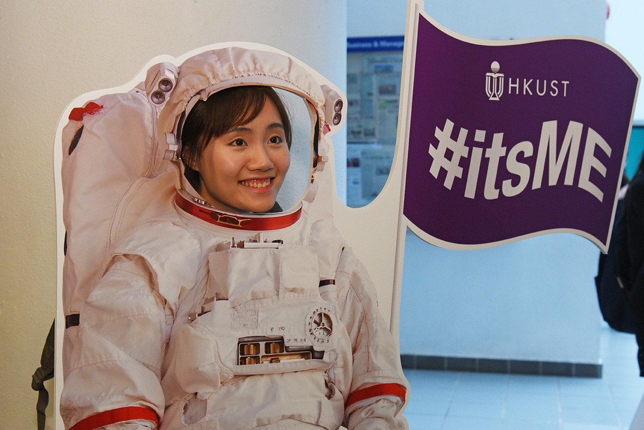 A participant taking photo using the astronaut-like photo props.
