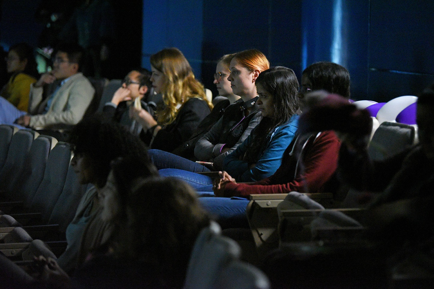 Audiences paying undivided attention and enjoying the movie.