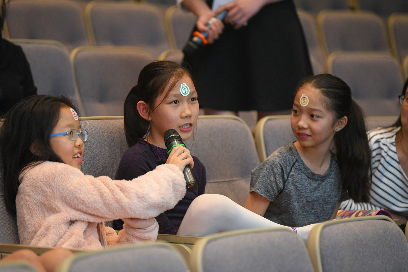 A child audience expressing her views.