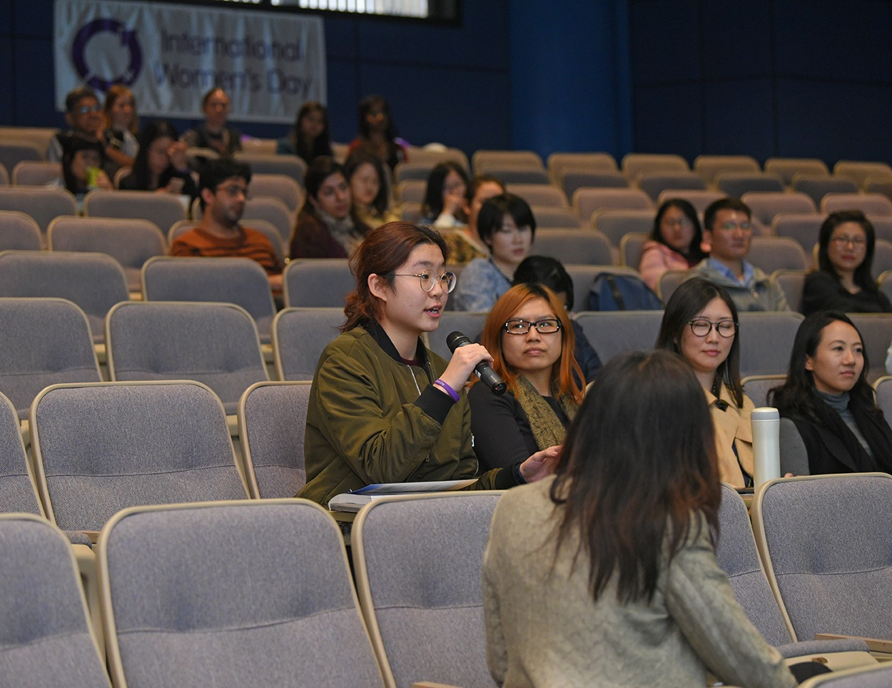 An audience expressing her views.