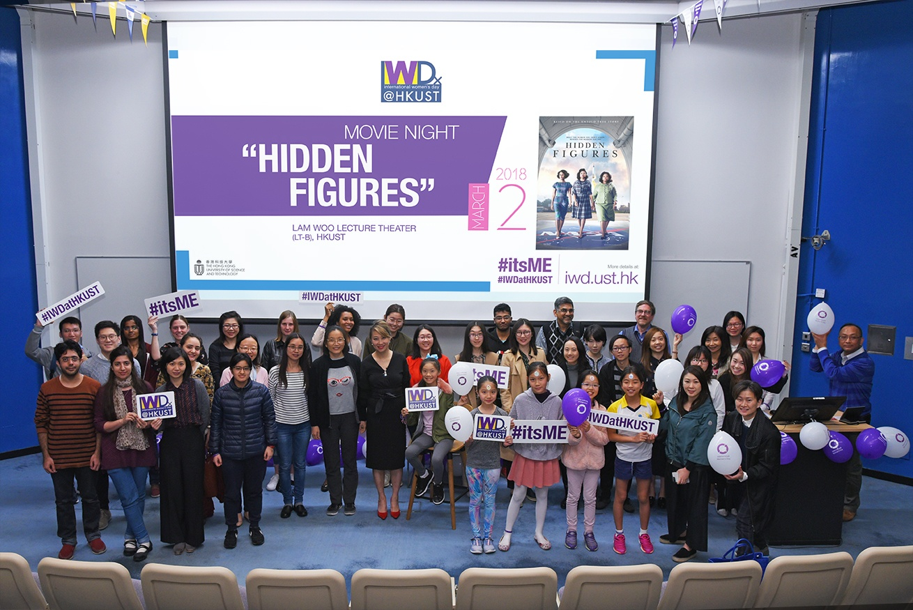 A group photo of all participants holding the photo props of IWD@HKUST.