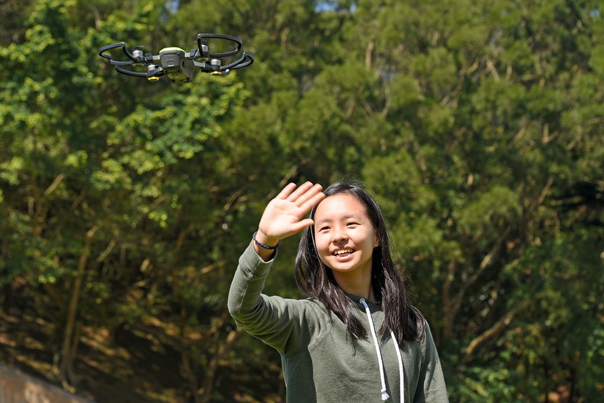A student using body gesture to control the DJI drone.