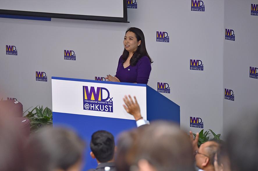 Keynote Speaker Ms Christina Zhang sharing on stage.