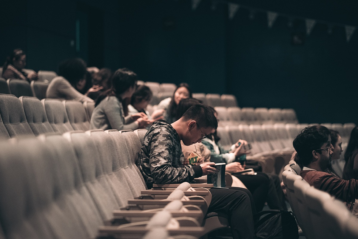Audiences in the theatre.